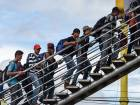 Honduran migrants climb an overpass to go to Tecum Uman, Guatemalan border with Mexico, in Guatemala City, on October 18, 2018.