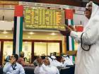 Investors cheer the rebound in share prices at the Dubai Financial Market