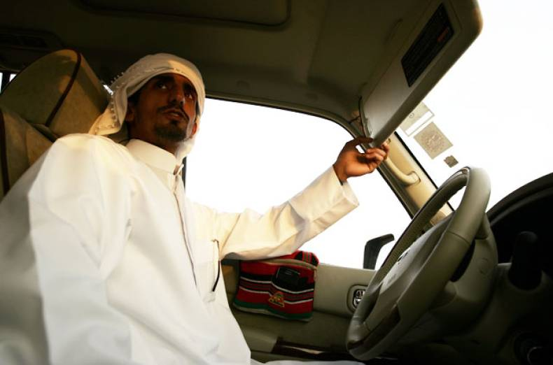 ajtebi-drives-in-the-desert-near-his-home-in-habab