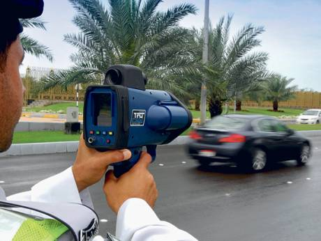 An Abu Dhabi policeman uses a new radar to spot speedsters