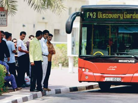 Passengers wait to board the F43 feeder bus near Discovery Gardens
