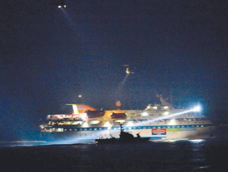Israeli helicopters circle above a ship of the Gaza-bound Freedom Flotilla