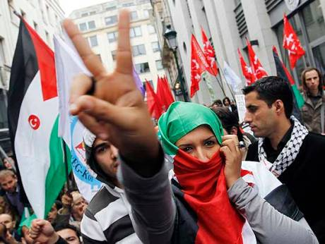 Demonstrators hold Palestinians flags in Brussels
