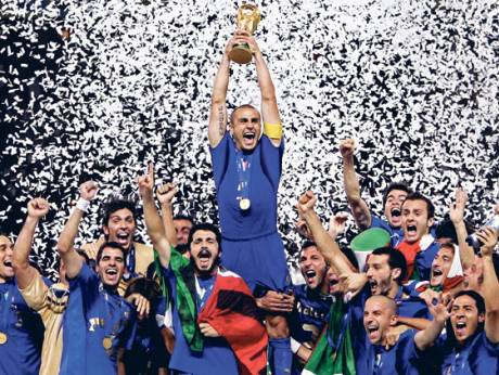Fabio Cannavaro holding the trophy with teammates