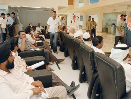 A crowd gathers at the reception desk of Emirates Identity Authority office to obtain their ID card