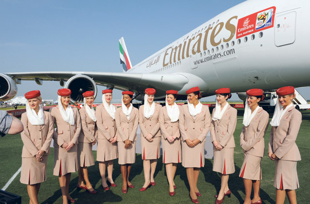 Cabin crew pose in front of an Emirates A380 aircraft on Tuesday