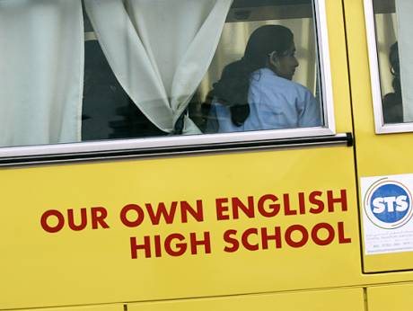 Students arrive for class at Our Own English High School