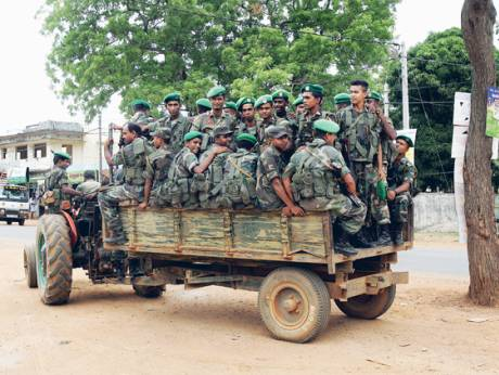 A tractor pulls a wagon full of Sri Lankan soldiers in the former LTTE stronghold of Kilinochchi