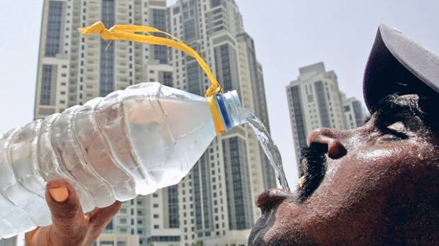 A labourer tries to beat the summer heat at a construction site in Dubai's Business Bay
