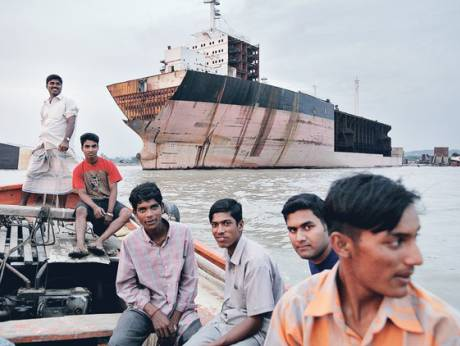 A group of Bangladeshis ride a boat in Chittagong
