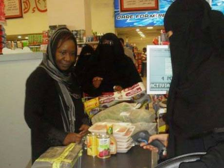Saudi women work as cashiers