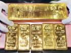 Gold slips, but on track for gains this week