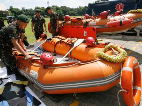 Military rescuers prepare life saving equipment
