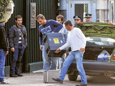 Police investigators arrive at the Russian embassy in Athens on Tuesday