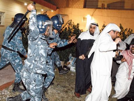 Elite special forces use batons against Members of Parliament at a public rally near Kuwait City
