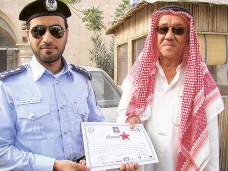 Winner Ali Ahmad Bu Zinjal receives the Caltex certificate on Tuesday
