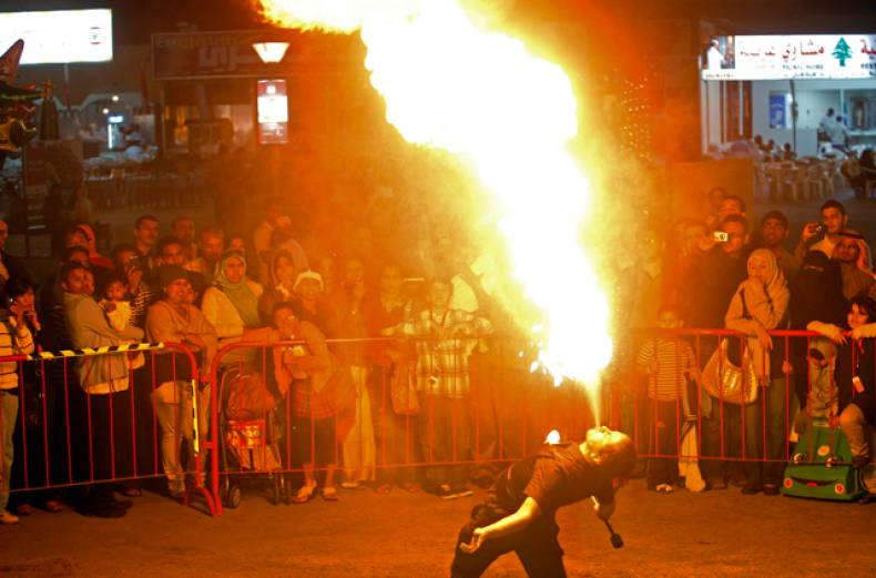 a-fire-eater-wows-the-crowd-at-the-global-village
