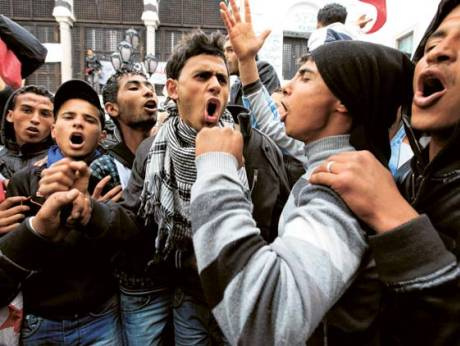 Protesters from Tunisia's poor rural heartlands chant slogan outside the prime minister's office