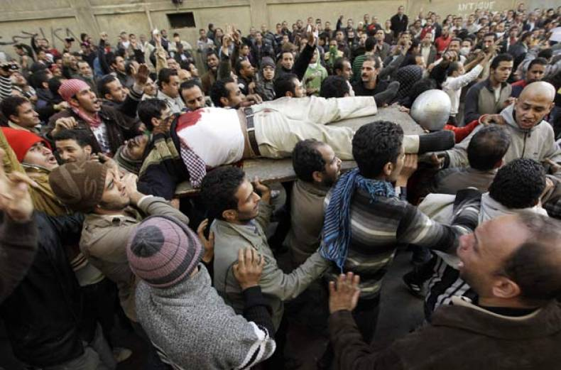 egyptians-carry-the-body-of-a-protester-who-was-killed-during-clashes-with-anti-riot-police-in-cairo