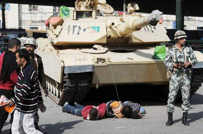 egyptian-soldiers-have-alleged-looters-captured-on-the-floor-and-tied-them-to-a-tank