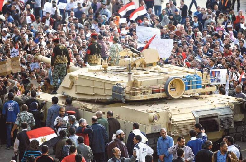 egyptians-surround-an-army-tank-during-protests-in-central-cairo