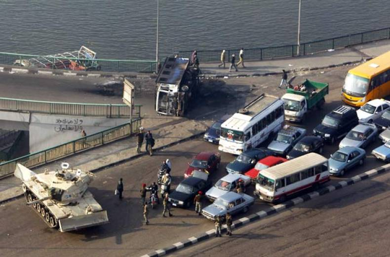 an-army-tank-blocks-traffic-on-the-october-6th-bridge-over-the-river-nile-near-tahrir-square