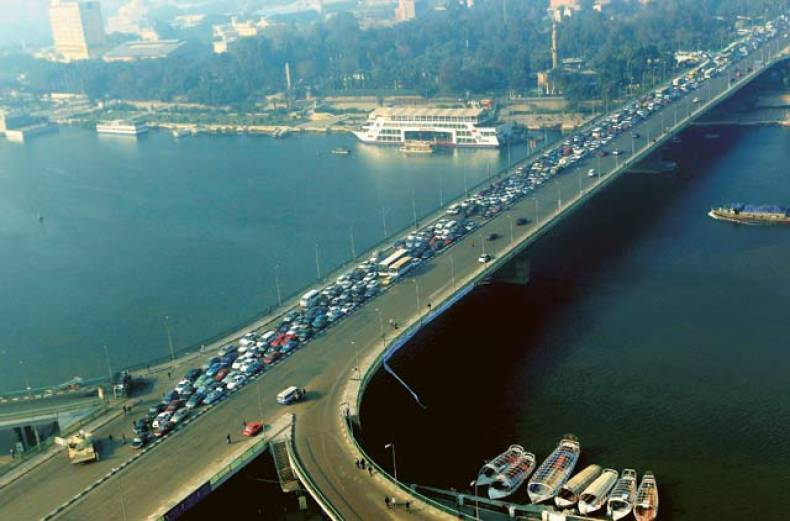 an-army-tank-blocks-traffic-on-the-october-6th-bridge-over-the-river-nile