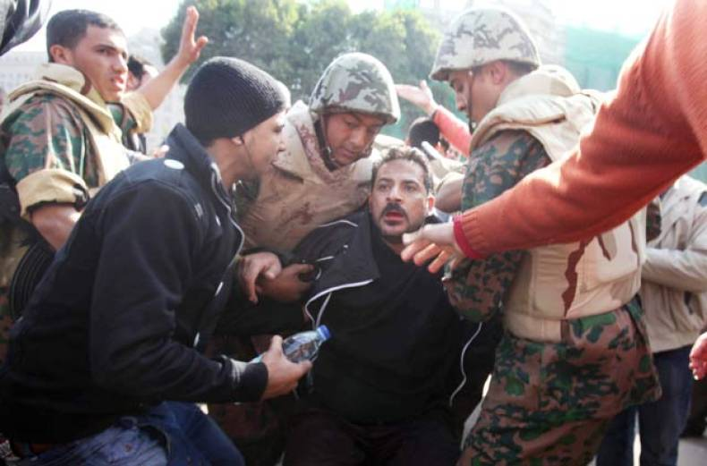 an-egyptian-man-scuffles-with-egyptian-soldiers-and-plain-clothes-police-in-cairo