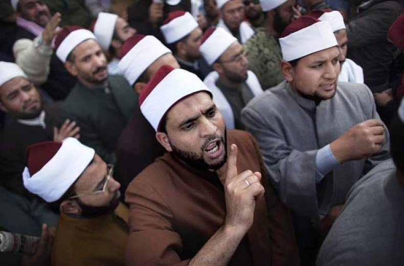 egyptian-muslim-clerics-shout-slogans-as-they-gather-in-cairo-s-tahrir-square-in-cairo