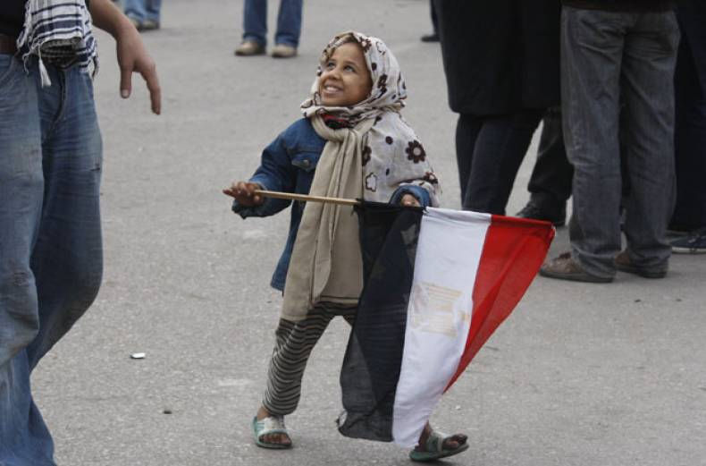 a-girl-holds-an-egyptian-flag-in-tahrir-square