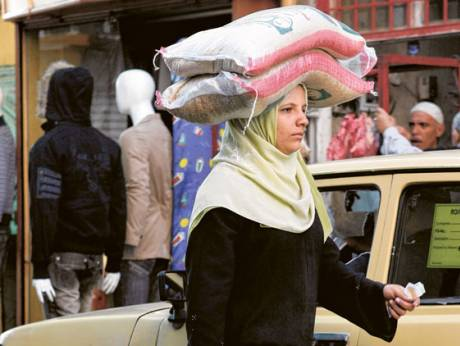 A woman carries groceries in Cairo, Egypt