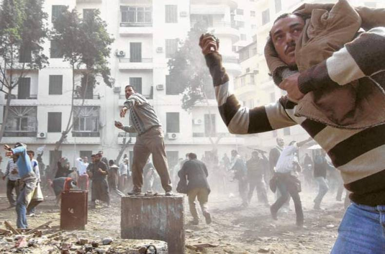opposition-supporters-throw-rocks-at-pro-mubarak-demonstrators-in-tahrir-square