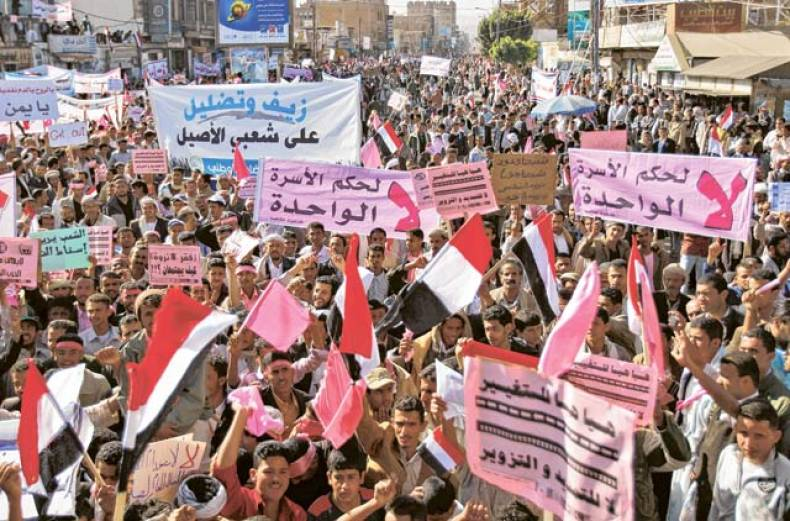 yemeni-demonstrators-wave-national-flags-and-hold-banners-during-a-demonstration