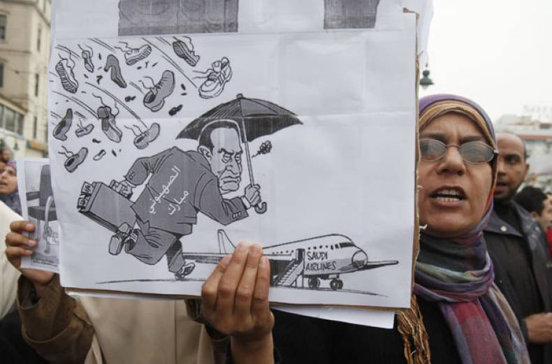 a-protester-holds-up-a-picture-depicting-president-mubarak