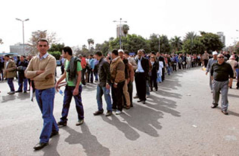 anti-government-protestors-wait-in-line-at-a-check-point