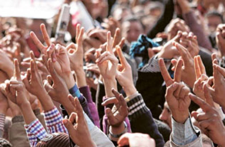 anti-government-protestors-rise-their-hands-in-the-victory-sign