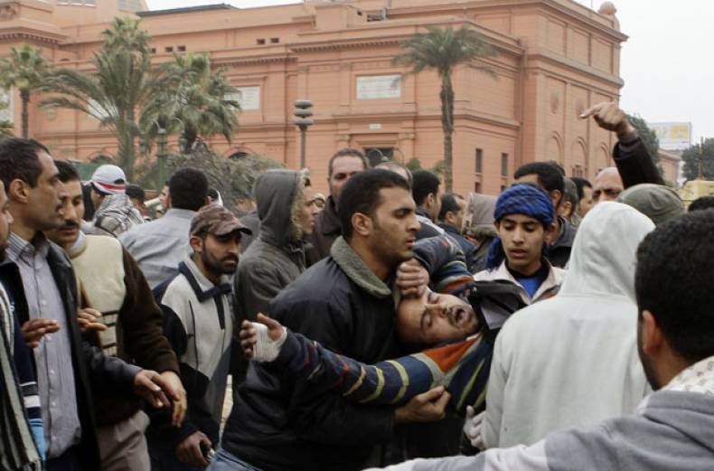 an-injured-opposition-supporter-is-carried-after-clashing-with-the-army