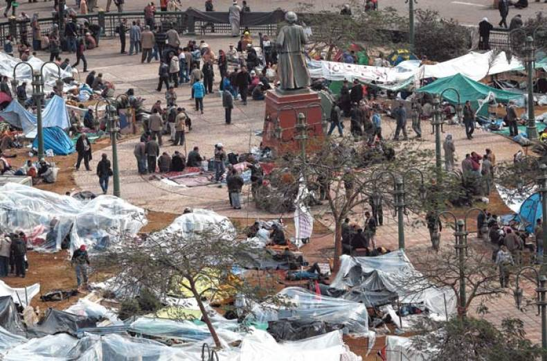 protesters-rest-in-makeshift-tents-as-many-of-them-continue-to-demonstrate-in-tahrir-square