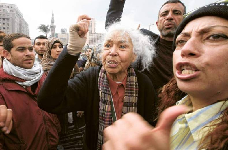 egyptian-feminist-nawel-al-saadawi-shouts-slogans-as-she-stands-with-some-protesters