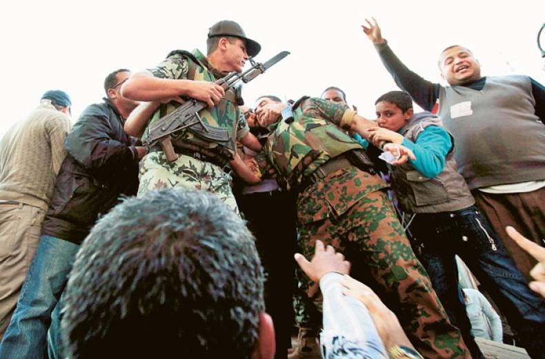 an-egyptian-soldier-is-kissed-by-anti-government-protesters