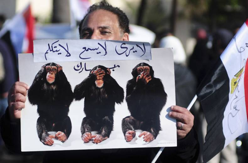 an-egyptian-protester-holds-a-poster