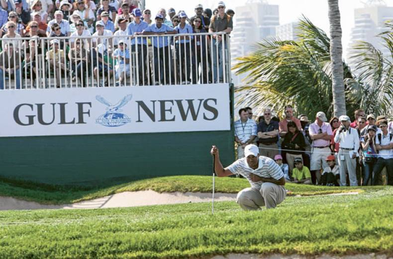 spectators-watch-as-tiger-woods-studies-his-shot