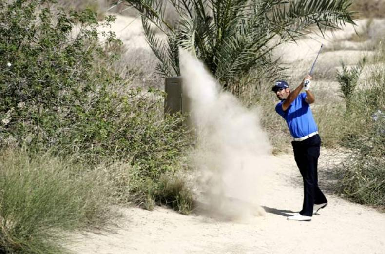 alvaro-quiros-of-spain-plays-a-shot-at-the-8th-hole