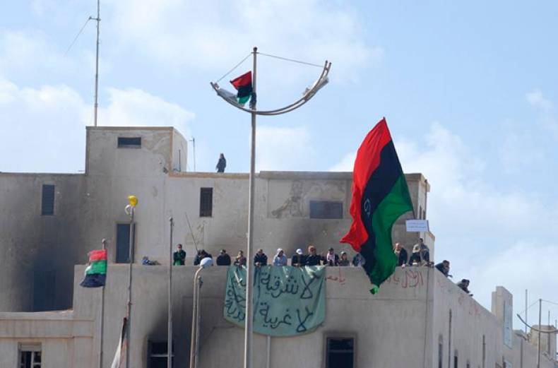 protesters-gather-at-the-top-of-a-building-in-libya