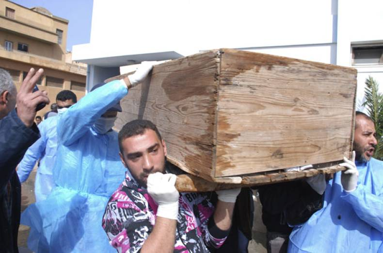 men-carry-a-coffin-at-al-jalaa-hospital-in-benghazi