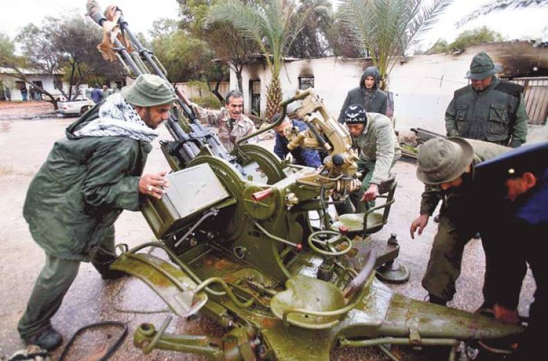 a-rebel-army-officer-teaches-the-use-of-an-anti-aircraft-gun-to-civilians