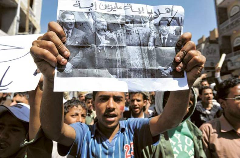 a-yemeni-protester-holds-a-poster-of-ousted-tunisian-president-zine-al-abidine-bin-a