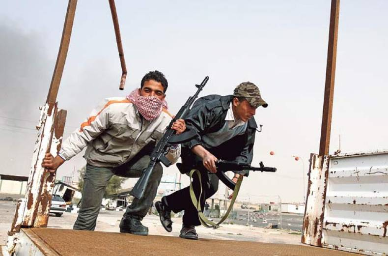 anti-government-tribal-rebels-prepare-for-possible-attacks-by-pro-gaddafi-loyalists-at-a-checkpoint