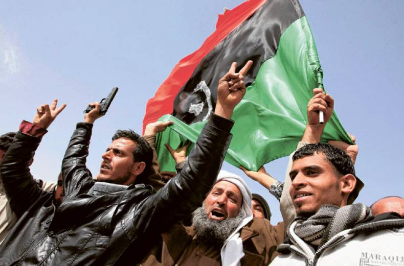 opposition-forces-wave-the-flag-of-the-kingdom-of-libya