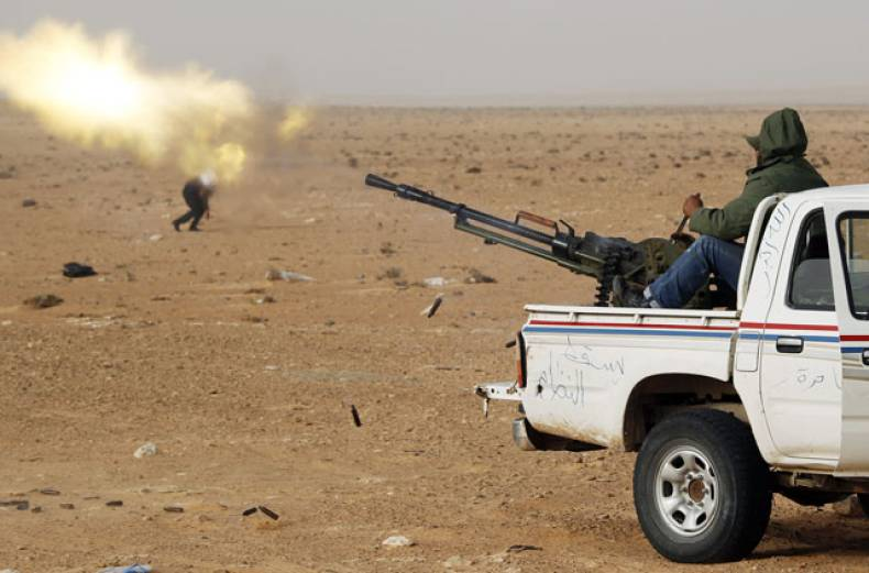 a-rebel-fighter-fires-an-anti-aircraft-gun